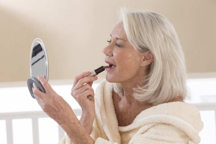 Older woman putting on makeup - look fabulous forever
