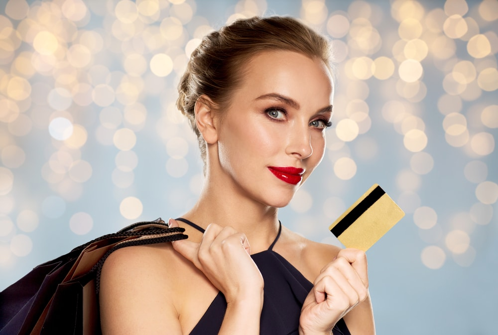 Woman holding gold credit card