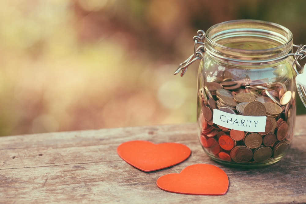 Jar of coins with charity sticker