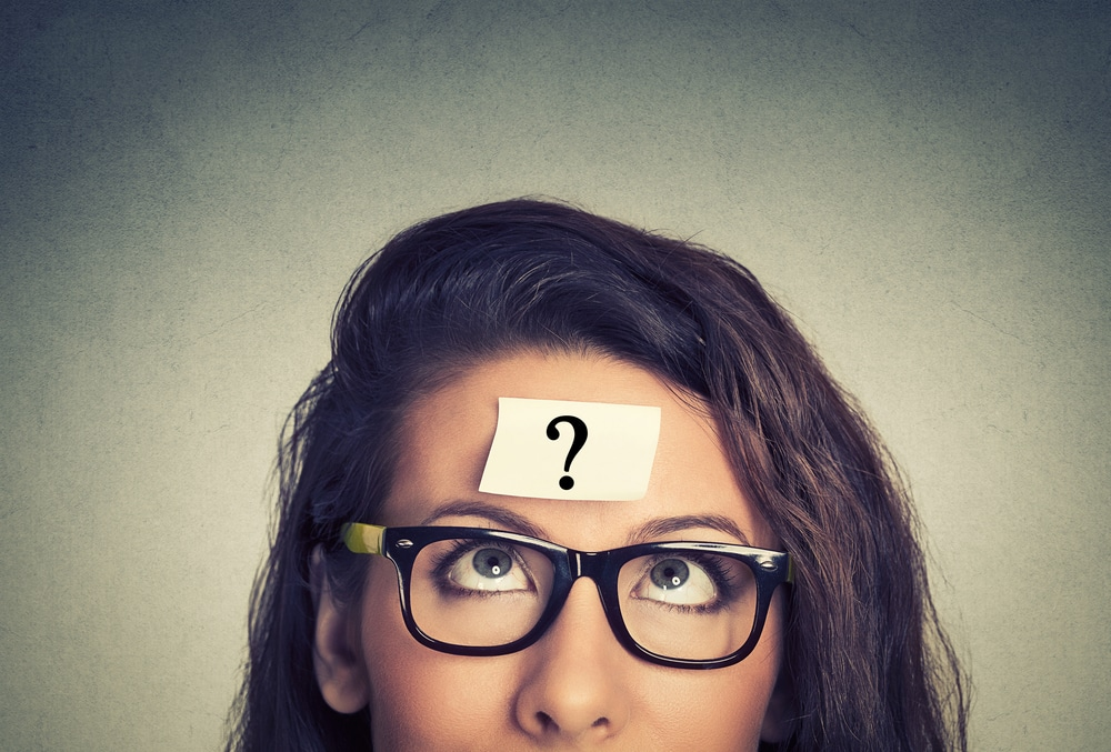 Woman with question mark post-it on her forehead