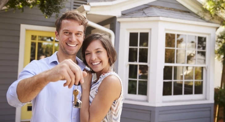 Couple outside their first home